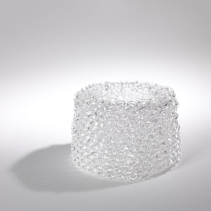 loops of continuous glass create a filigree-like pattern in a cylindrical form