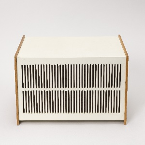 Rectangular form; white lacquered sheet steel housing flanked by red elm wood sides; slotted grill in two horizontal rows across front face
