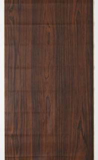 Very dark wood grain design, possibly rosewood, produced by Con-tact brand, USA.