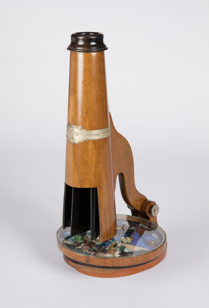 Burled wood telescope style parlor scope with swivel base/viewing disc and opening object chamber.