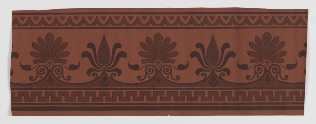 Classical-style border with wide central band containing alternating anthemion and pineapple motifs. Geometric running bands above and below. Printed in two shade of brown on a lighter terra cotta ground.