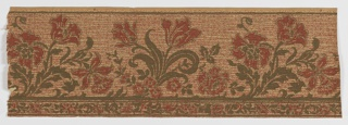 Repeating motif of stylized floral bouquet, including tulips and daffodils, among others. Narrow band of floral and foliate motifs at bottom edge. Printed in red and green on speckled ground resembling screen mesh.