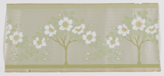 Art nouveau design with repeating motif of petite tree containing five large flowers. Low hanging or weeping outer branches overlap with tree on either side. Printed in greens, white, and ocher on a pale green ground. Ungrounded paper