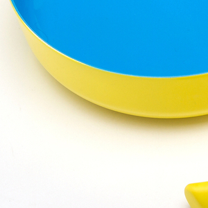 Eatwell bowls, cups, and spoons help people with Alzheimer's recognize and engage with food. On the exteriors of the bowls, red and yellow stimulate appetite. Blue interiors look different from food.