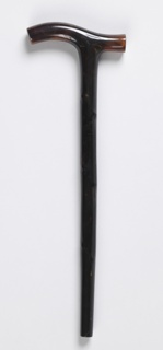 Simple dark-colored tortoiseshell parasol handle with curved grip