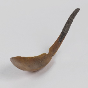 Horn molded into shape of spoon; light-colored section likely mountain sheep horn