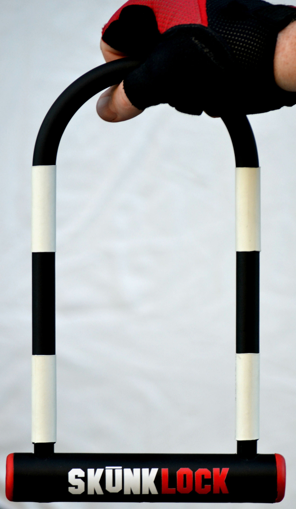SkunkLock is a U-shaped metal bicycle lock painted with black and white stripes. When broken, a foul smell deters theft.