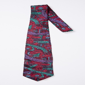 Necktie with a fantastic or futuristic scene that suggests roads, cables and tower-like buildings. Woven in dark red, purple, teal, and dark blue.