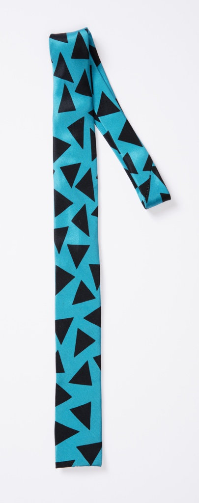 Necktie in bright blue patterned with a seemingly random arrangement of black triangles.