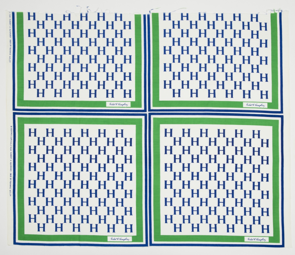 Campaign textile for Hubert H. Humphrey with alternating rows of the letter H enclosed by a green and blue border. Signature of Hubert Humphrey is in the bottom right of green border. Each square meant to be cut to make a campaign scarf.
