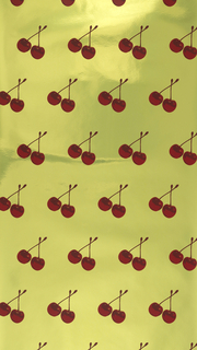 Red glossy cherries pop against a yellow chrome background on this scented wallpaper.