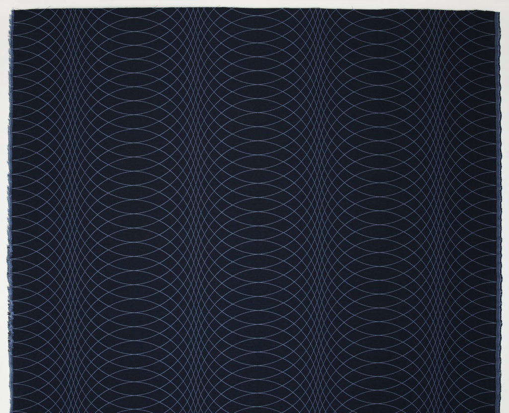 Length of woven textile with a deep blue ground and pattern of curved intersecting lines in medium blue.