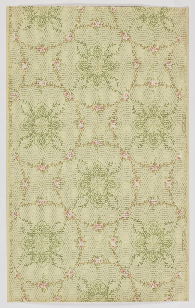 Repeating design of circular shapes or wreaths composed of flowers and foliage with a quatrefoil motif in the center, each touching at four points. Printed on light green ground.