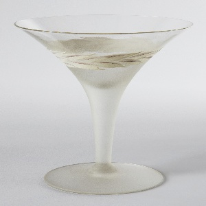 Conical glass with laurel motif painted in white and mauve around flared bowl. Sandblasted below painted band to cover stem and base