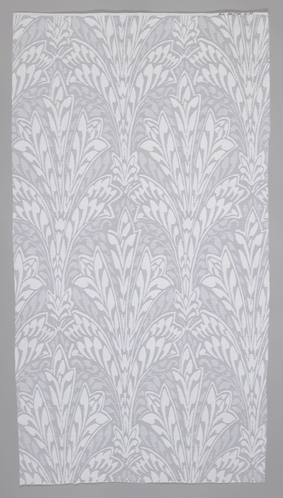 Length of sheer knit with white stylized organic pattern.