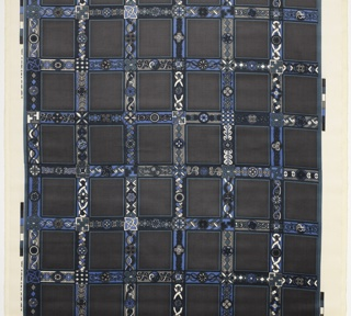 Gray velvet background of squares bordered by blue, white and black abstract celtic geometric shapes.