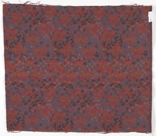 Heavyweight fabric with a crackle or mosaic-like pattern in rose, rust, and shades of blue.