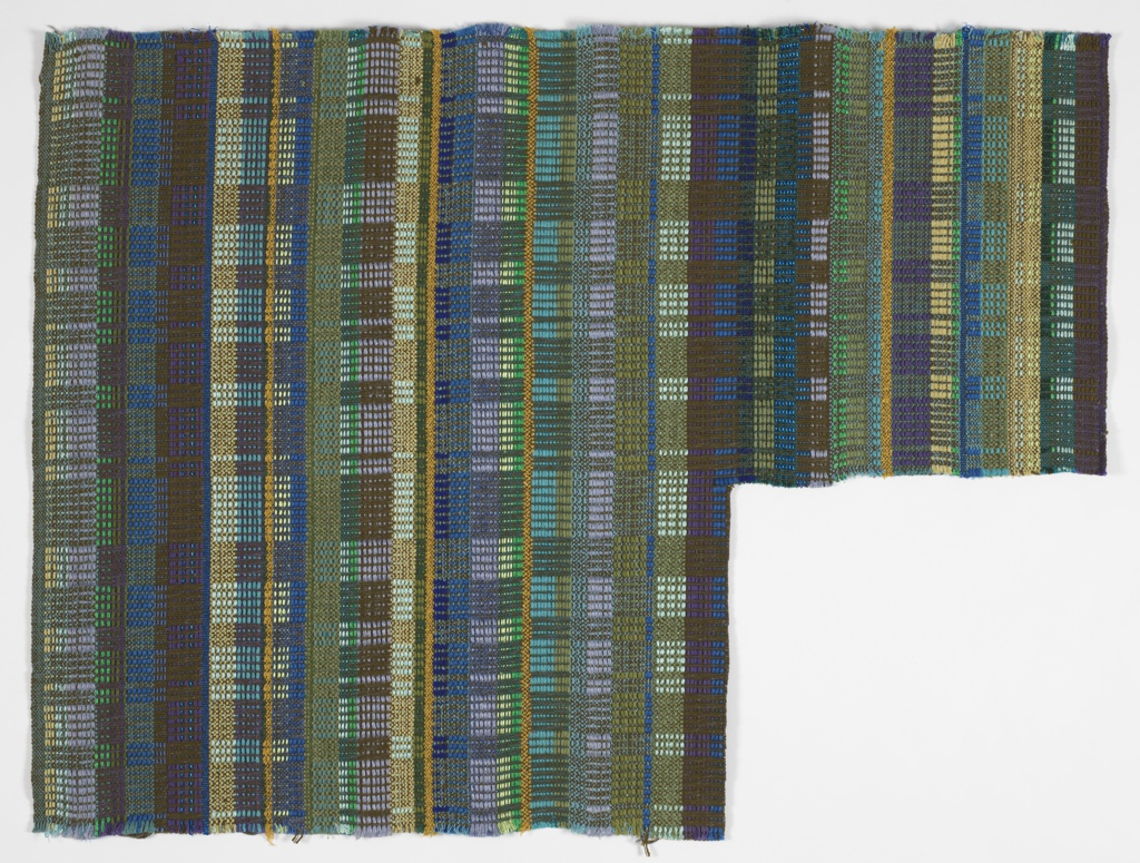 Length of plaid fabric in greens, blues, brown, and purple with metallic thread.