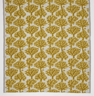 Woven velvet with trees in gold pile, surrounded by shiny gray texture.