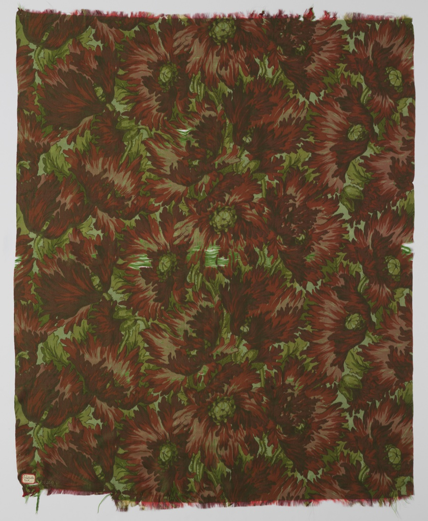 Green weft and polychrome printed warp in chiné technique in design of a large scale closely-spaced flame poppies.