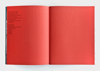 An open magazine has two red pages. A poem is printed in the Latin alphabet and in braille. A flat pattern of small black dots covers both pages.