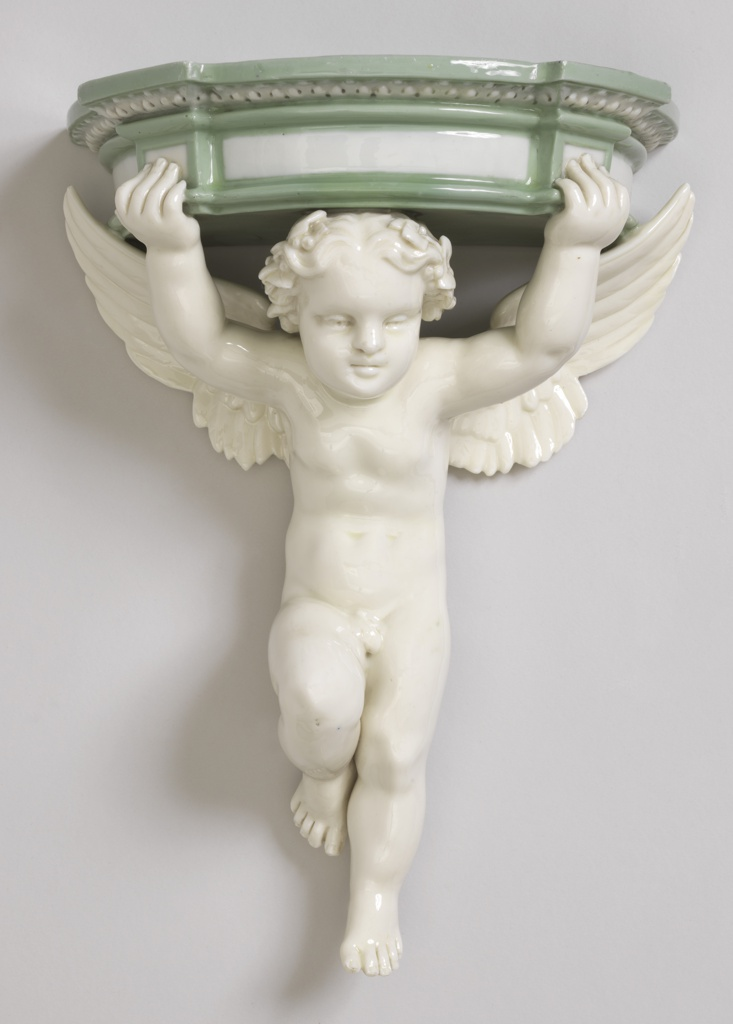 A putto, wings outstretched and hands raised, supporting a semicircular shelf with moldings in pâte-sur-pâte.