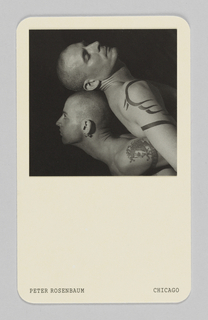 "Business card with rounded corners. In upper center, black and white image of two men, one laying on the other's back with eyes closed. Both men are tattooed with shaved heads. ""Peter Rosenbaum"" printed in serif type in black in lower left corner and ""Chicago"" in lower right. On verso, contact information for Rosenbaum photography."