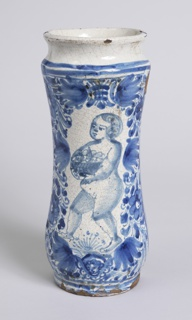 Drug jar, decorated on one side in blue with figure of putto bearing a basket of fruit, within a framework of flowers and foliage.