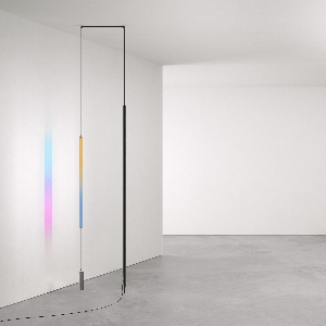 Lamp comprised of a suspended LED strip, a narrow rectangle of dichroic glass, and a counterweight.