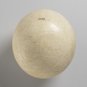 Ostrich egg carved with allegories of the four continents--Africa, America, Asia, Europe.