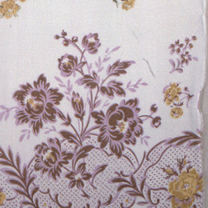 White ground with a border print in purple, brown and tan, of rocaille scallops and large-scale sprays of roses. Small roses in brown, tan, green and black scattered over ground. Both selvedges present.