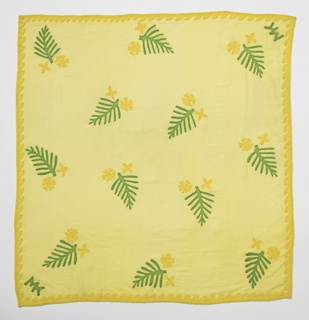 Square scarf of yellow silk crepe with an appliqué design of leaves and small flowers in green and yellow. Initials MK appliquéd in two corners.
