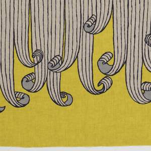 Yellow linen with a large-scale print of curling white ribbons outlined in blue.