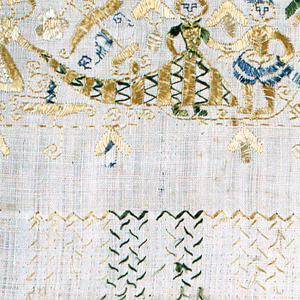 Embroidered border on natural colored silk with clothed male and female figures, florals, and sailboats in gold and green.  Female figure wears a crown and a child appears to be dancing.  Running stitch around the border with arrows embroidered on the outside of the rectangle.