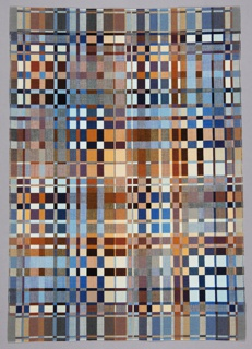Rectangular weaving with a grid-like pattern of small squares and rectangles in shades of black, white, gray, blue, rust, and ochre.