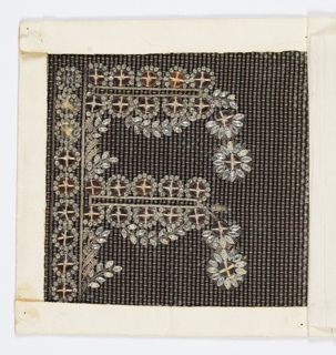 Stylized pattern of stiff foliage worked in silk and metallic thread with white and orange glass brilliants on a black ground with a green and violet rib weave.