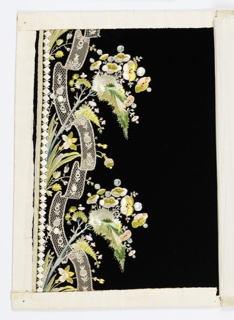 Black velvet embroidered in border design with flower sprays and narrow bobbin lace applied.