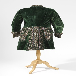 Green velvet coat embellished with applique floral sprays in metallic threads, spangles, net and multicolor paste gems.