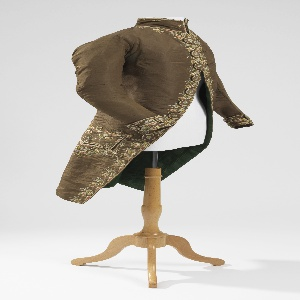 Man's coat of brown grosgrain embroidered with floral design in pale polychrome colors.