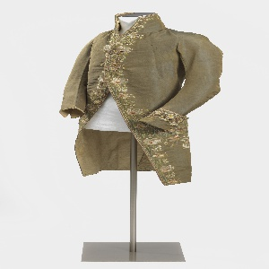 Man's coat of changeable brown and blue grosgrain embroidered with a large floral design in pale polychrome colors.