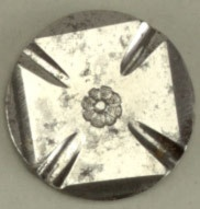 Circular button with face in design of Maltese cross. Steel shank.
