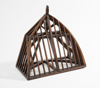 """Model of a roof frame as a conglomeration of frame types: front as a flat, slanted """"shed"""" roof; right side, a roof with a convex curve to create a dome; left side with angled """"gambrel"""" roof line; back left open as if to be mounted on a building. Inside elements arranged as beams and joints of the supporting structure."""