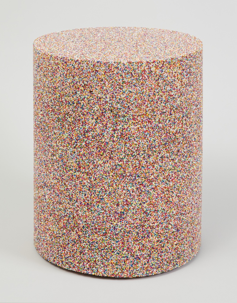 Circlular stool made with a mixture of multi-colored sugar sprinkles and resin.