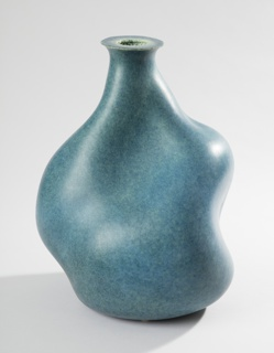 Bulbous, irregular plastic body tapering to narrow neck with circular mouth; smooth, mottled blue outer wall; white to blue inner wall retains the texture of the plastic granules that make up the body.