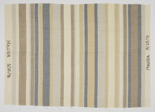 Wide and narrow vertical stripes of brown, tan, blue, light blue and off-white on linen. Printed with a special dye-box system.