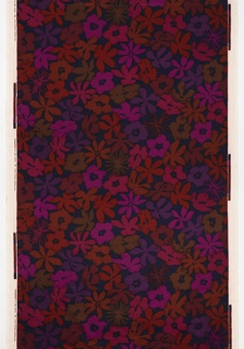 Large-scale abstract floral in violet, reds and pinks on a navy velvet ground.