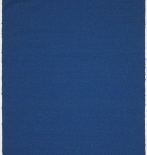 Textured solid woven with a royal blue warp and slubbed medium blue wool and blue metallic wefts.