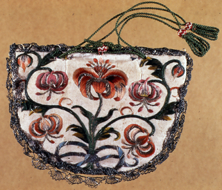 White ribbed silk semi-circular purse with drawstring top, embroidered with polychrome silks in floral designs and edged in silver bobbin lace. Lined with blue taffeta; braded green silk cord at top.