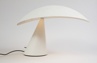 White form composed of broad, overhanging elipitcal shade attached at one side to angled conical base; swtich and black cord at rear of base.