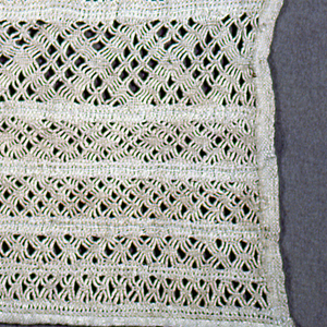 Two columns of withdrawn element work pattern in white.